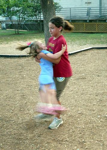 Angela spins Alana around