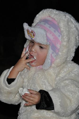 Sadie eats a marshmallow