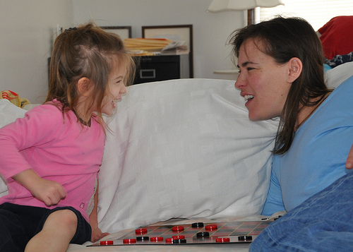 Alana and Julie in a fierce game of checkers