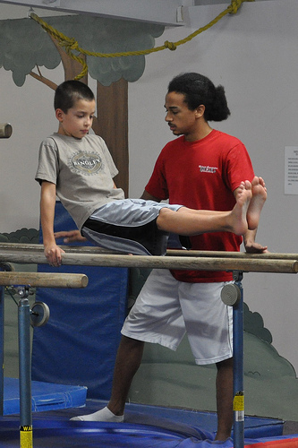 Carson on the parallel bars