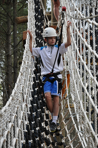 Carson descends from the ropes course