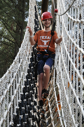 Benton descends from the ropes course
